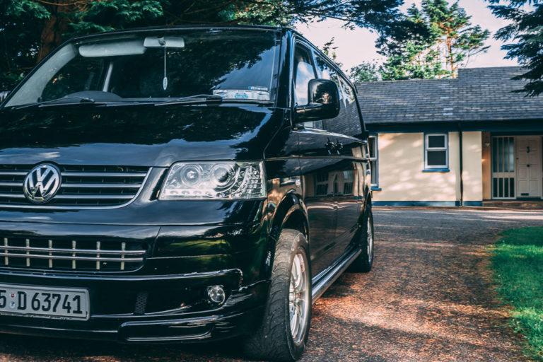 Black VW van side view